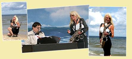 Saxophonistin mit Pianist beim KOnzert am Meer
